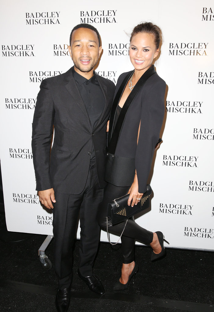 John Legend and Chrissy Teigen coordinated in black tuxedos at the Badgley Mischka show.