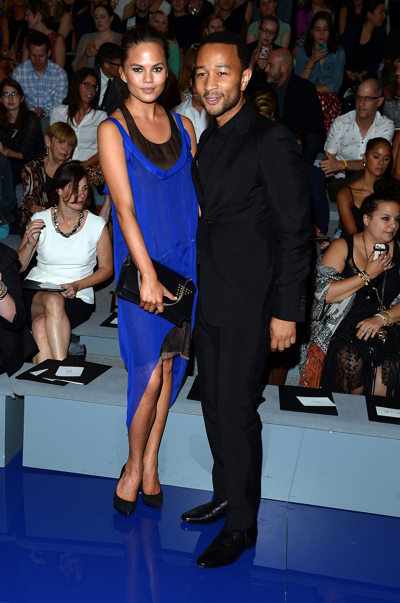 Chrissy Teigen popped in an electric blue dress while posing with John Legend at the Vera Wang show