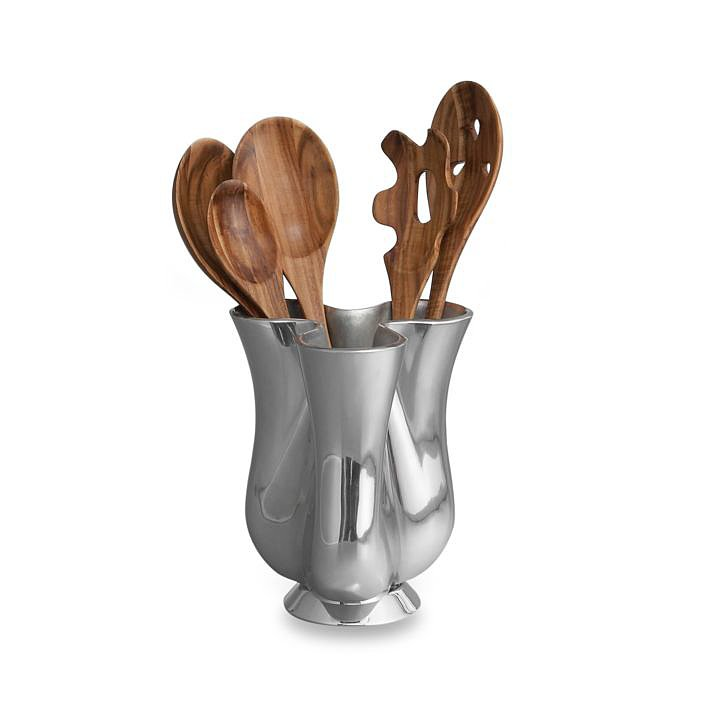 Have you ever seen a cooler kitchen jug and tool set ($150)? Each of the striking spoons was carved from natural wood.