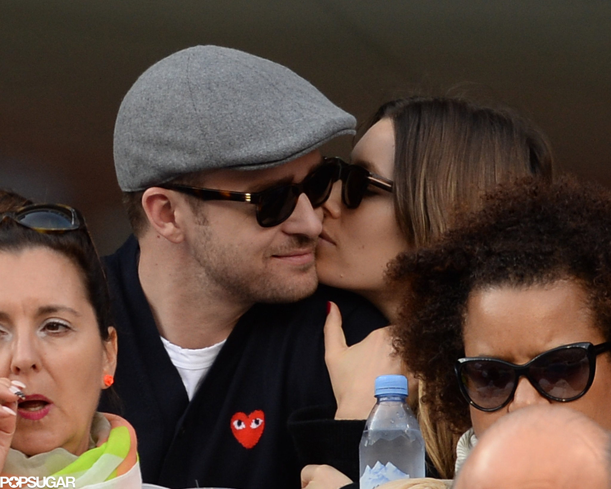 Justin Timberlake stole a kiss from Jessica Biel in the stands of the US Open.
