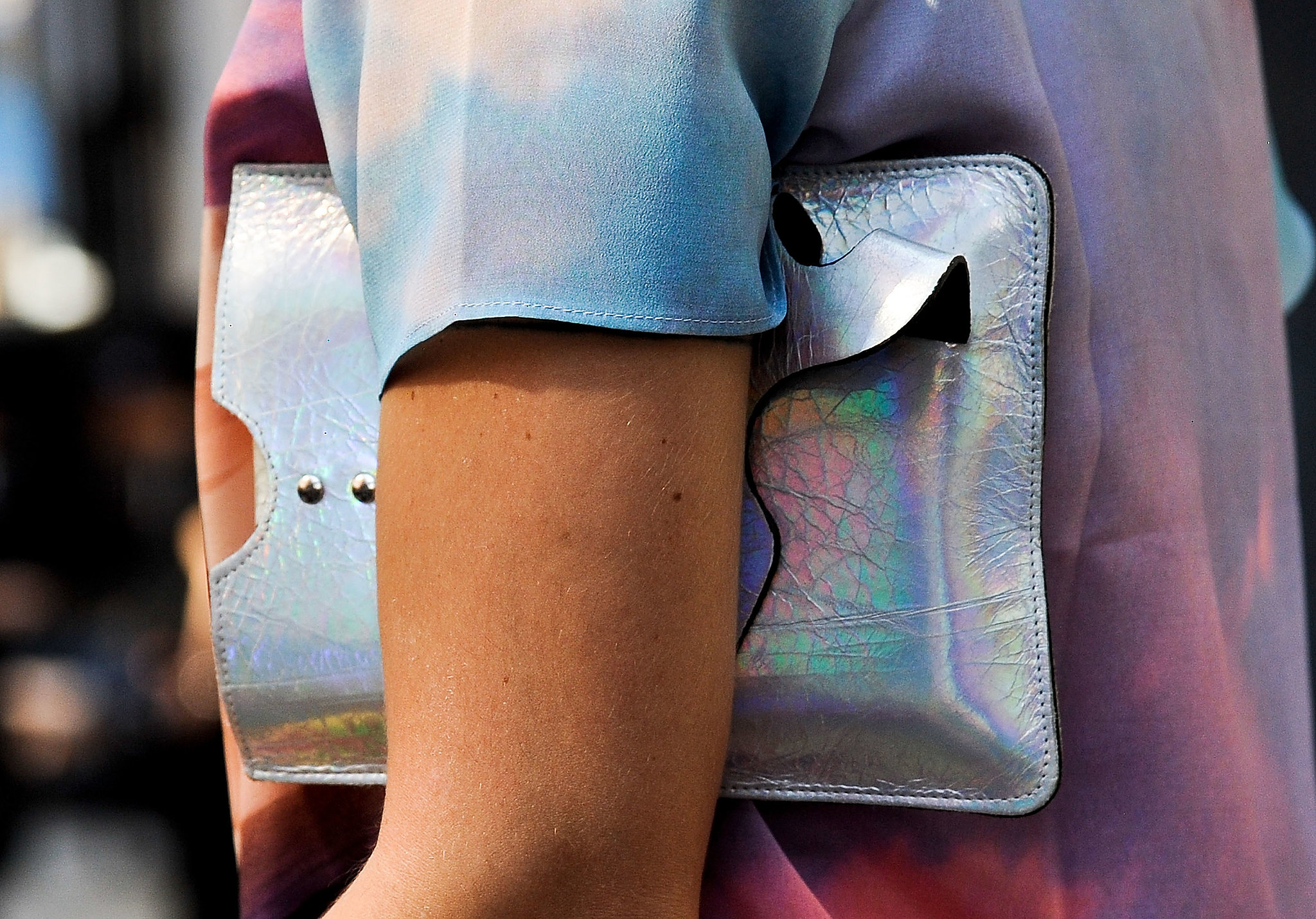 A holographic clutch against a little ombre is completely eye-catching.