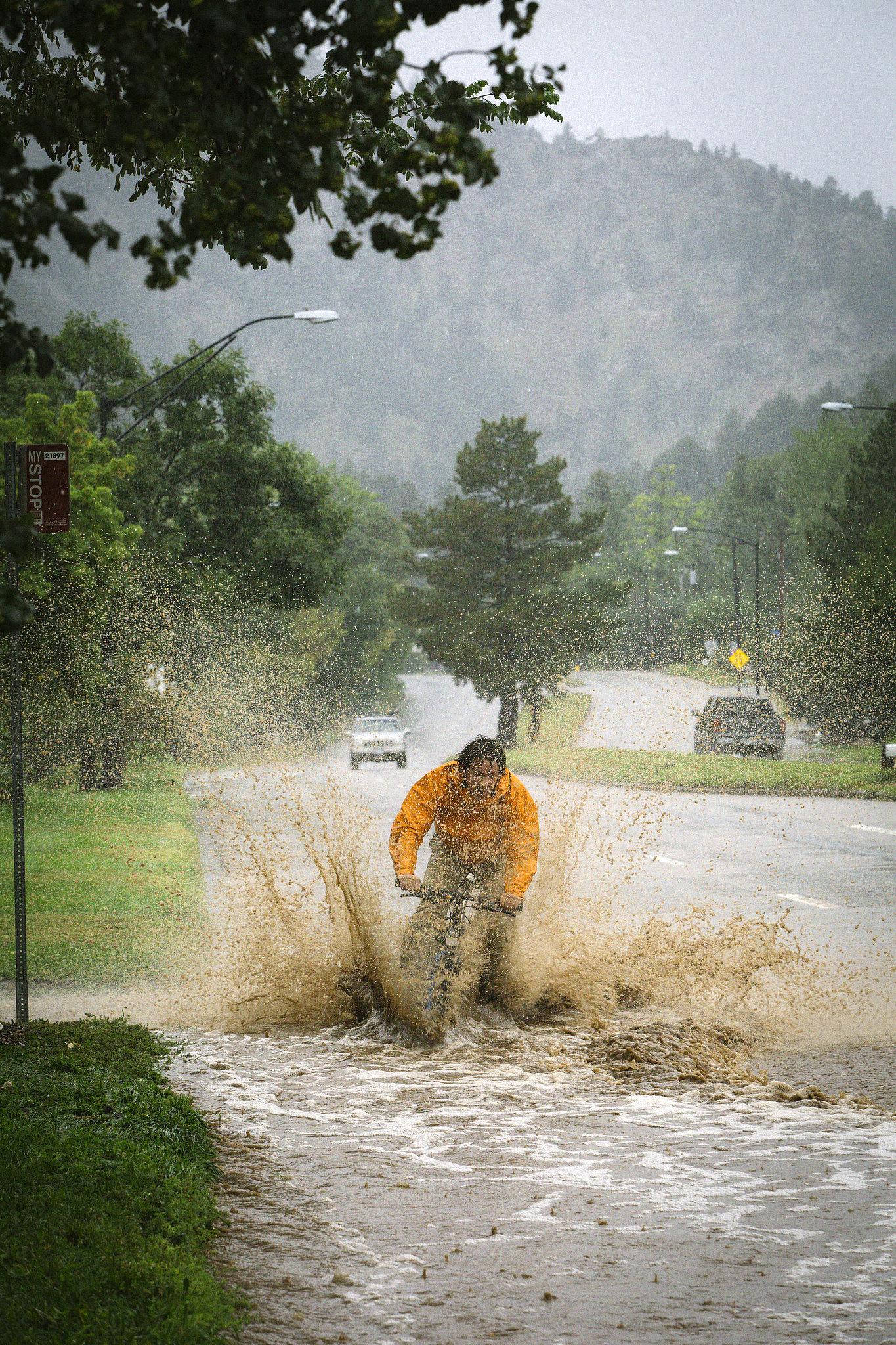 A biker splashed through the street in Boulder, CO.