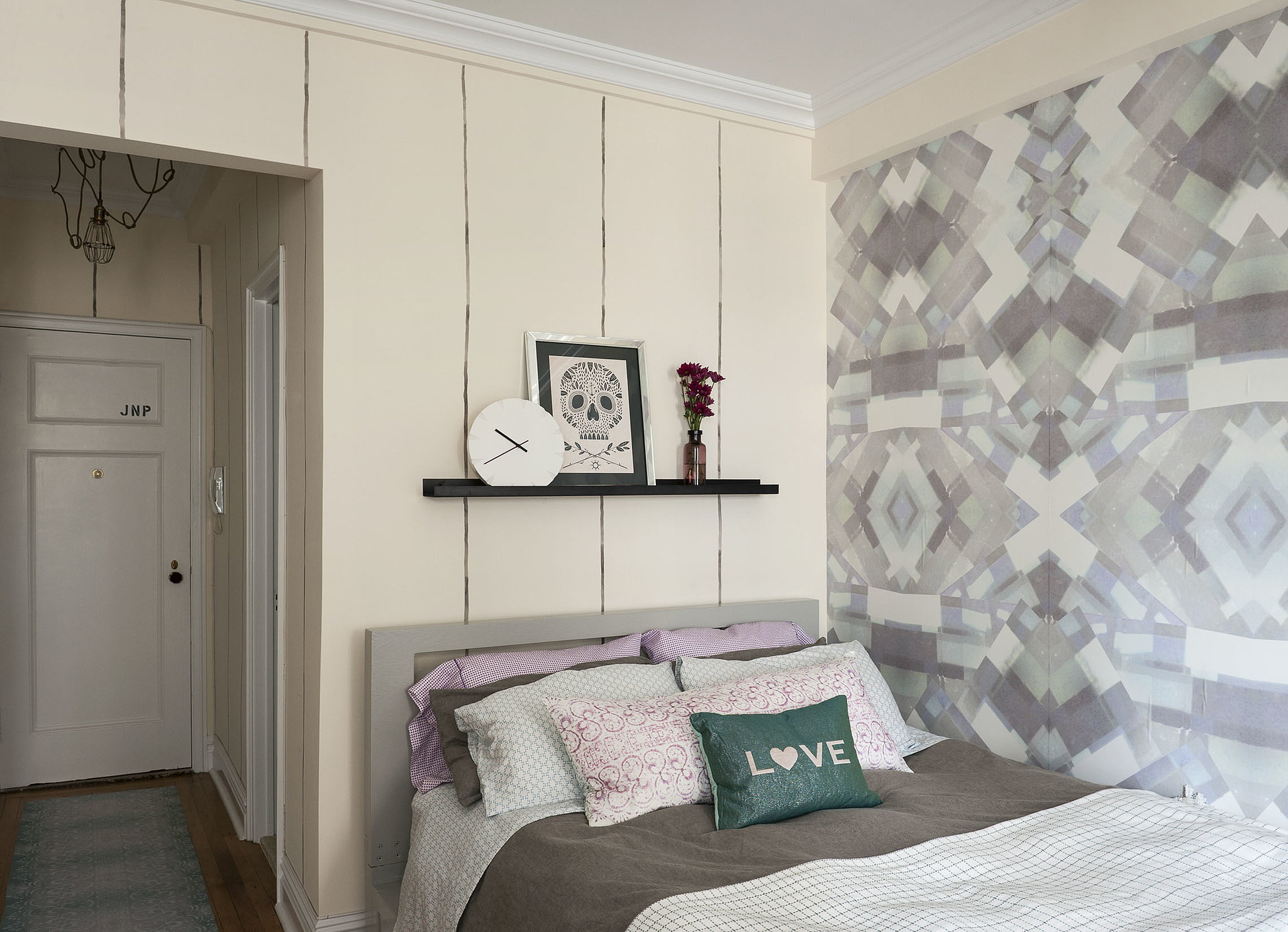 """PS: We love the wall art. How did you do that? It is from your Femme and Gem collection? LS: The one wall (next to the bed) is wallpapered in our """"Gemma"""" print (in Sapphire) from our """"Femme and Gem"""" collection. It's removable, and you can hang it yourself! For the other walls, we hand painted watercolor pinstripes to add personality and to tie everything together. Photo by  Matthew Williams via LABLstudio"""