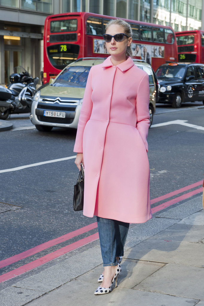 Pretty in a pink coat and polka-dot heels.