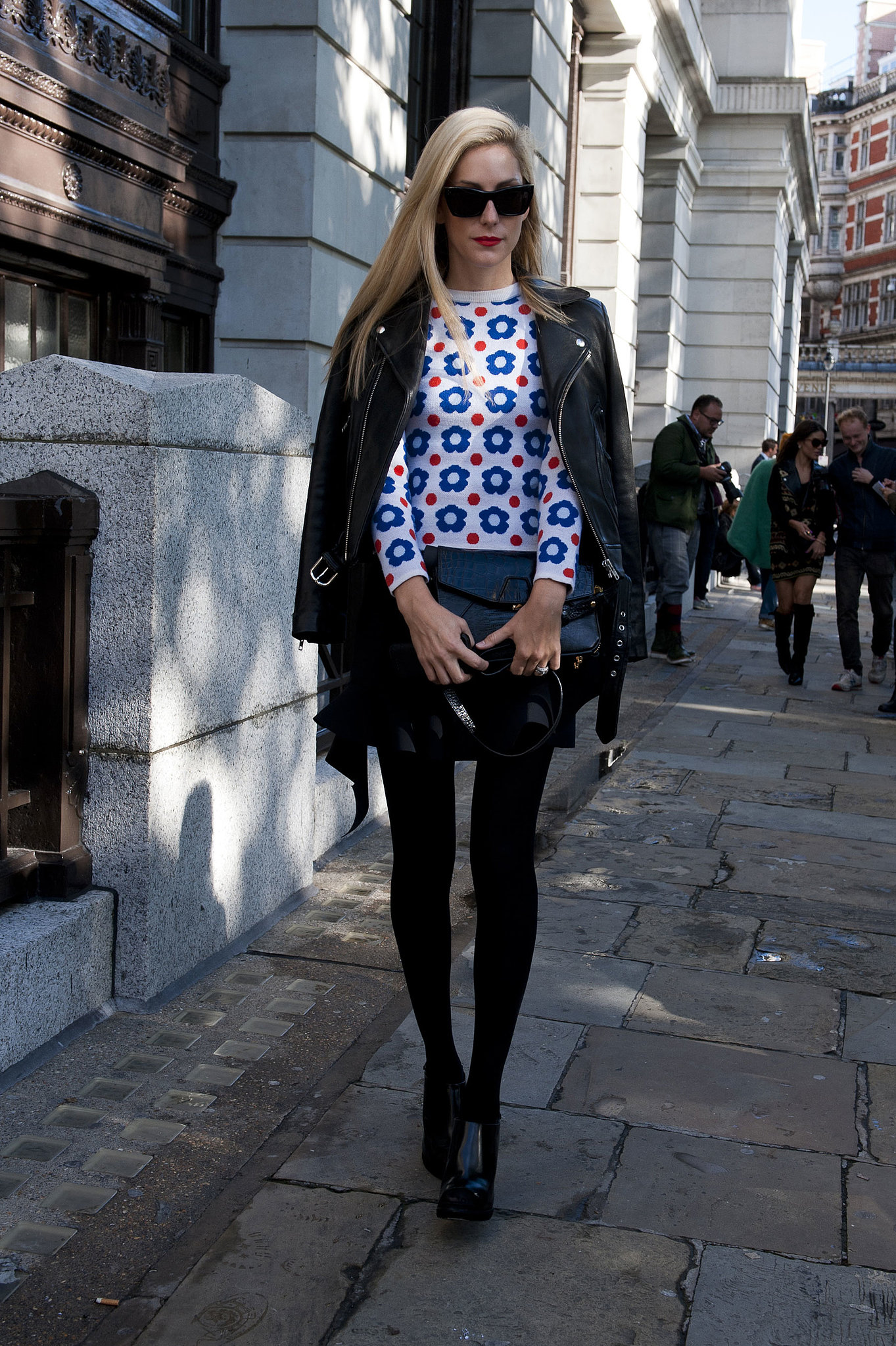 Joanna Hillman countered a quirky sweater with sleek black.