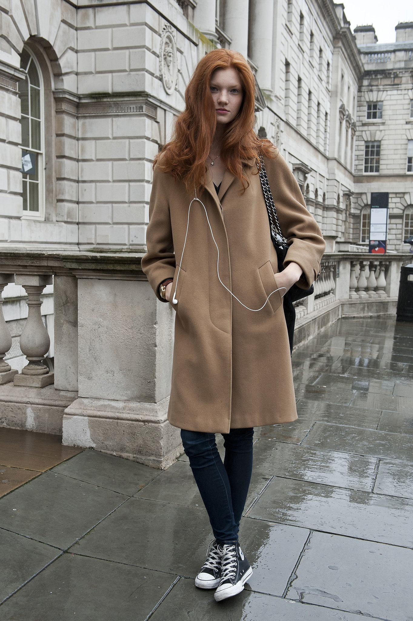 A model style citizen in a classic camel coat.