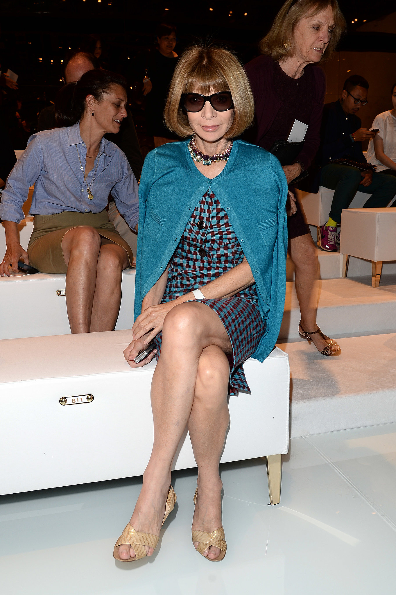 Anna Wintour readied for Gucci's Spring runway show in a teal ensemble.