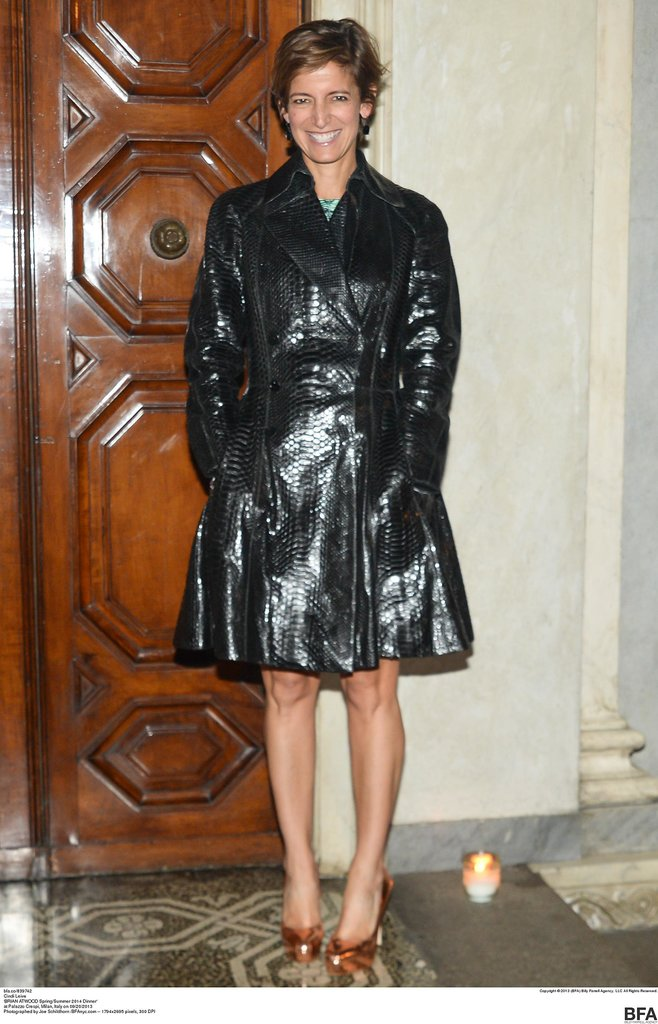 Cindi Leive let her shoes make a statement paired with a high-shine trench at Brian Atwood's Milan dinner.