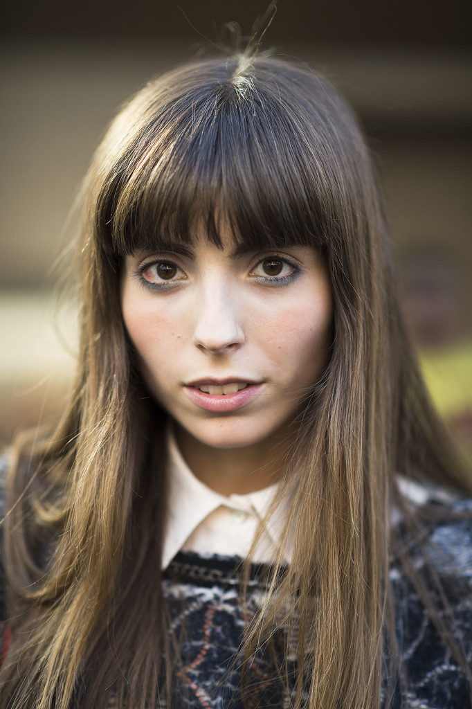 This girl's bangs drew serious attention to the icy blue shadow swept under her eyes. Source: Le 21ème | Adam Katz Sinding