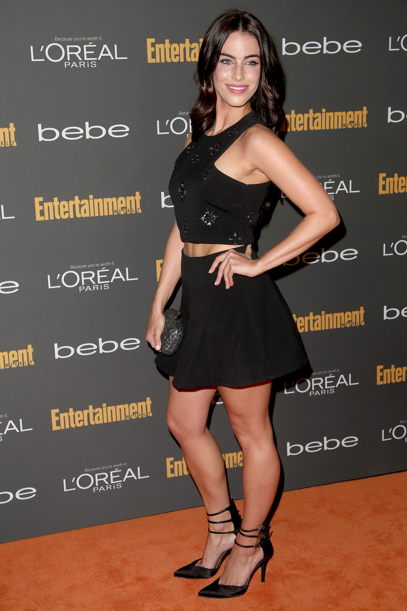 Jessica Lowndes put her midriff on display in a black crop top and a black miniskirt at the pre-Emmys bash.