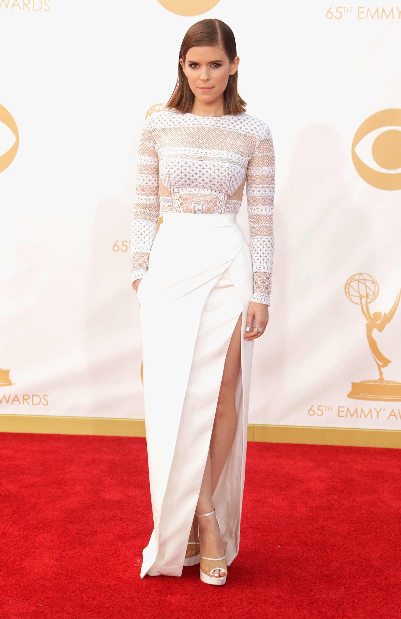 Kate Mara picked crisp white J. Mendel with a high slit that flashed