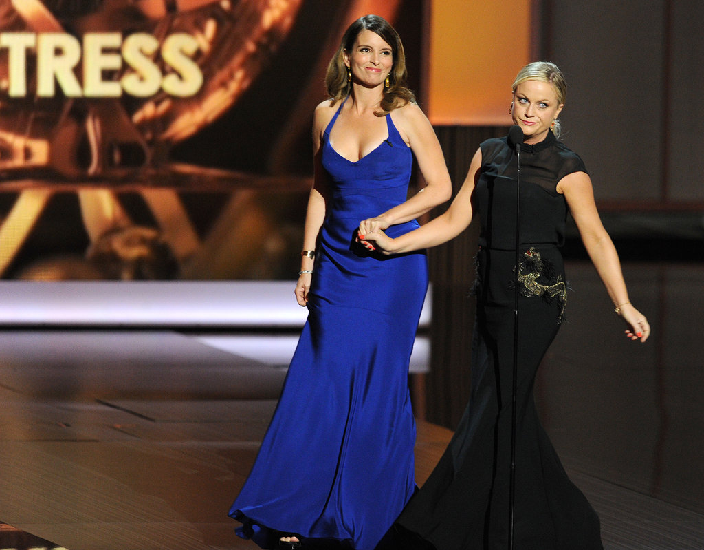 Amy Poehler and Tina Fey brought the laughs when they hit the Emmys stage.