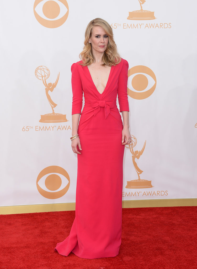 Sarah Paulson played a lady in red, picking a deep v-neck Carolina Herrera New York gown on the Emmys red carpet.