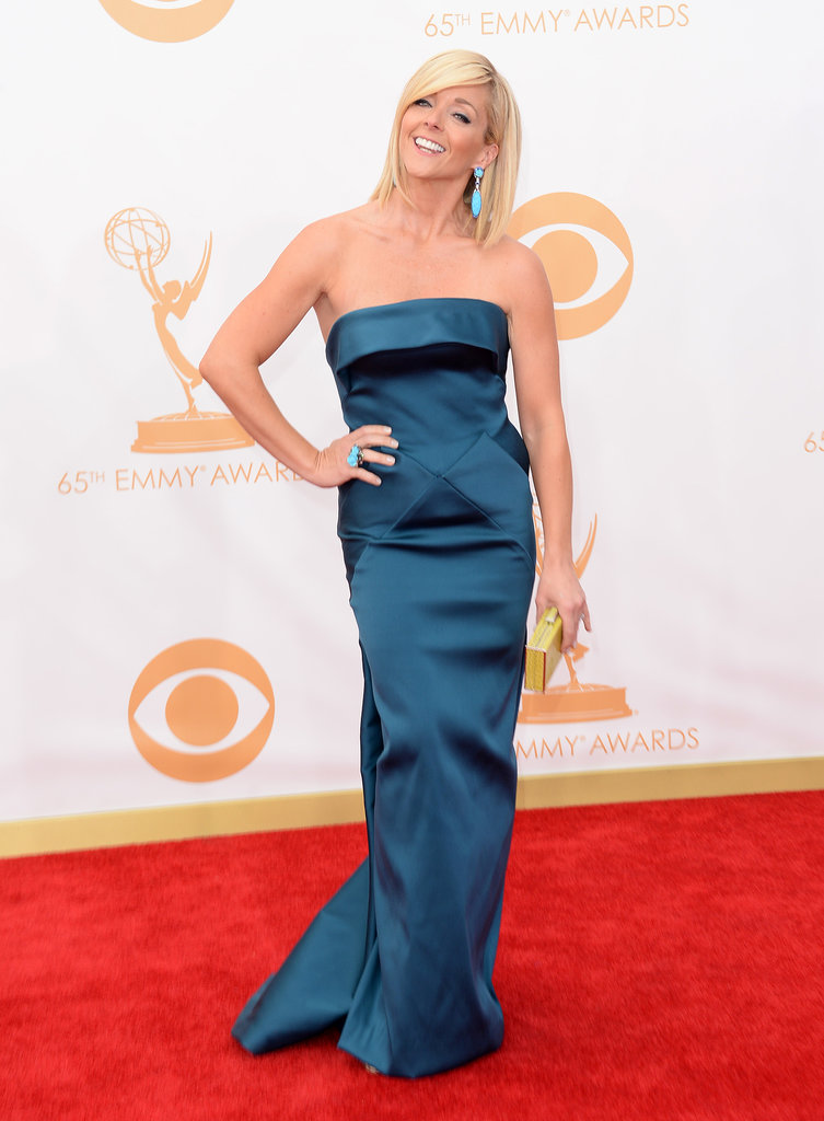 30 Rock star Jane Krakowski teamed a strapless teal gown with a simple gold clutch for her walk down the Emmys red carpet.