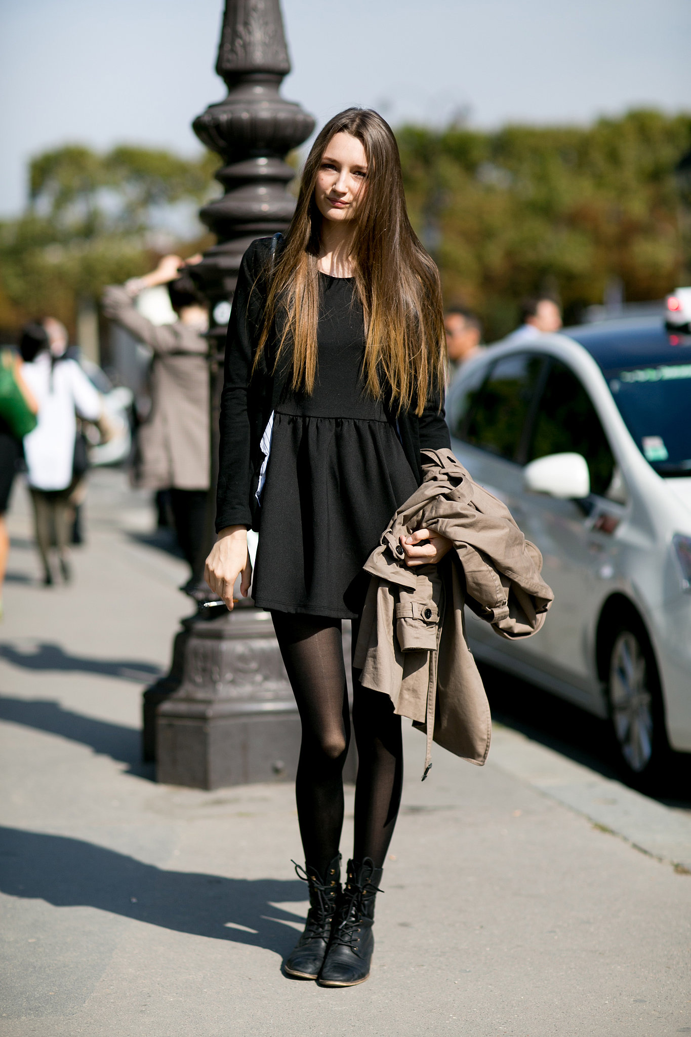 the black dress executed with black boots