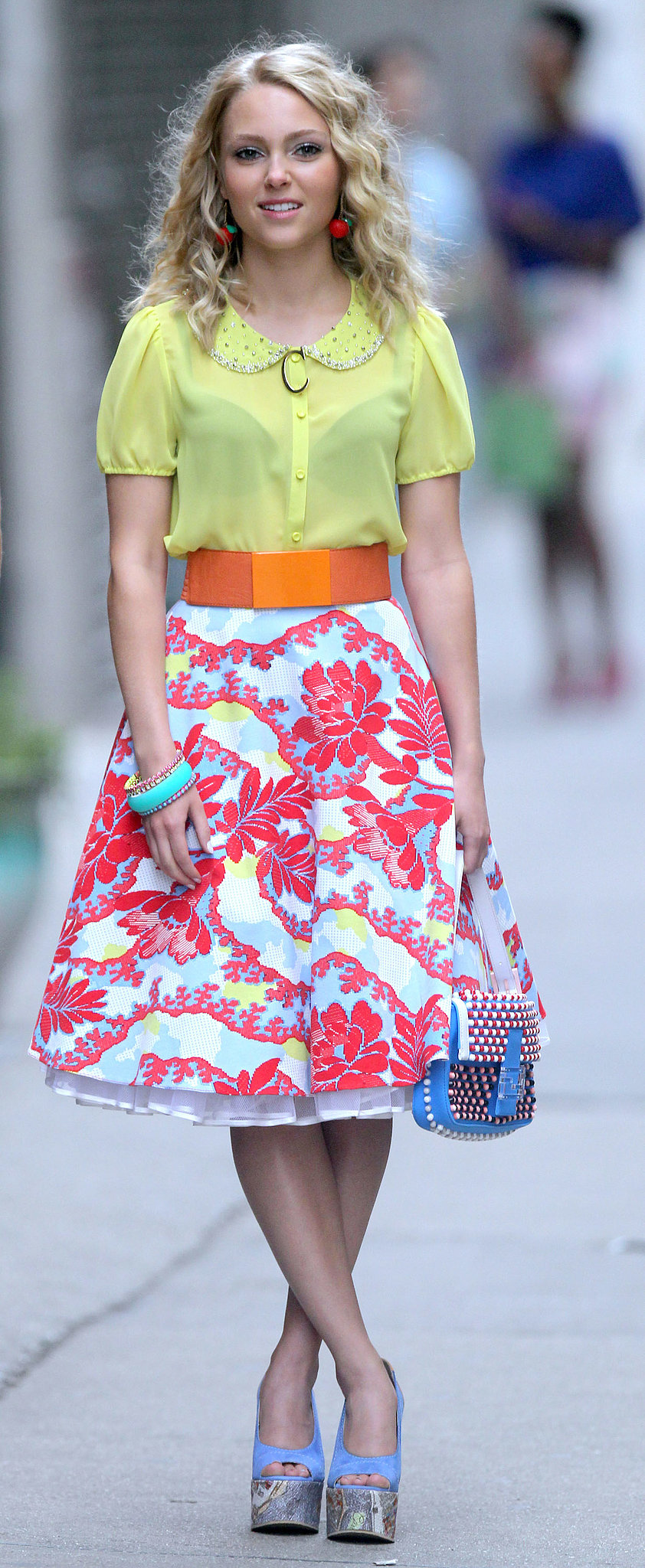 Carrie showed off her Summer brights in a sunny Peter Pan collar top, a printed Topshop skirt, and Carven platform wedges. Pair this blooming Modcloth midi ($70) with a pretty pastel blouse for your next soiree.