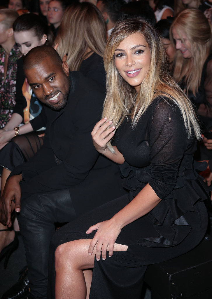 Kim and Kanye were all smiles during the Givenchy show.