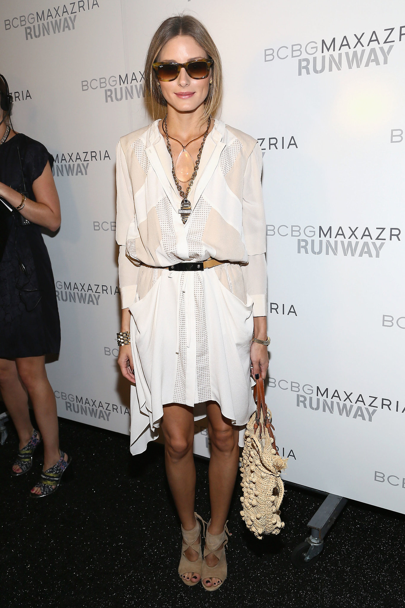The easiest way to add shape to an easy Summer dress? Cinch it with a belt, as Olivia did at BCBG Max Azria.