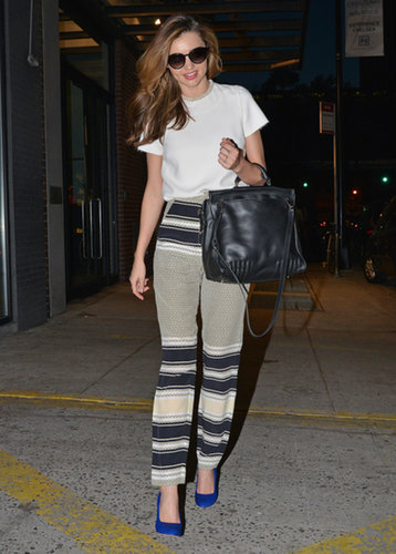 During an evening out in NYC, the supermodel continued her love affair with printed bottoms then finished with equally punchy cobalt pumps.