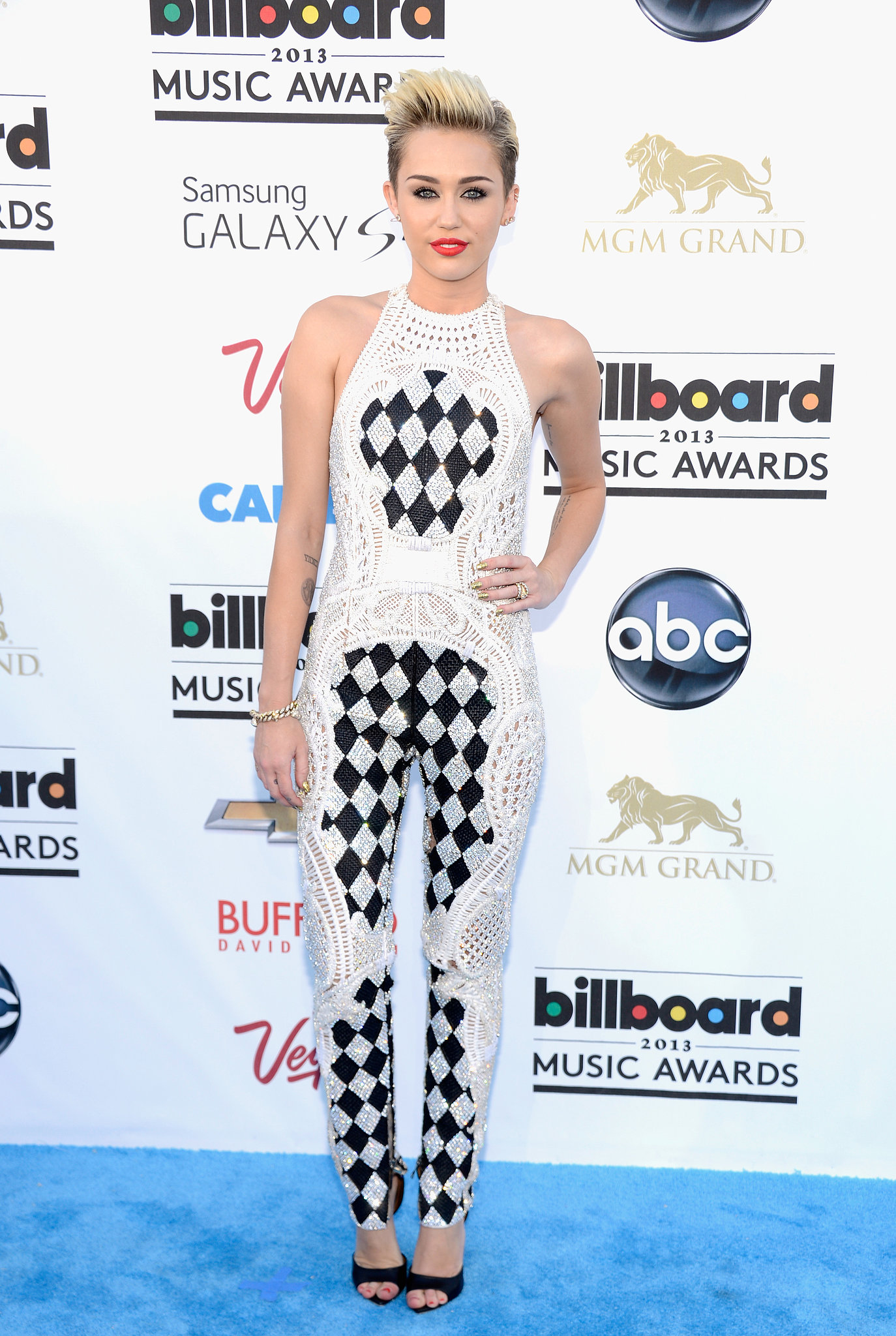 For the 2013 Billboard Music Awards, the singer donned a black-and-white Balmain jumpsuit featuring an intricately woven texture and some serious all-over checkerboard print. Givenchy heels and a bold red lip completed her rocker-chic style.