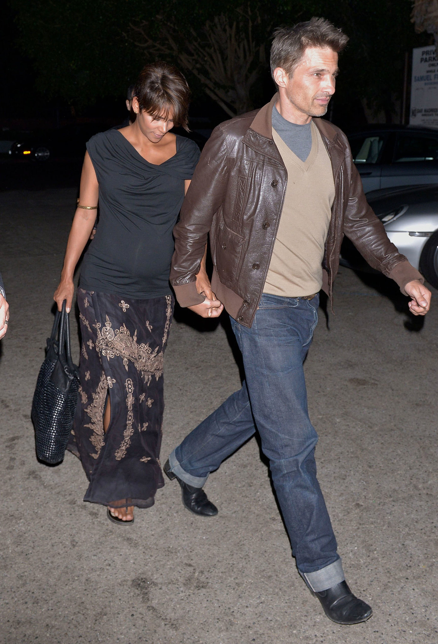 For a slightly more formal evening out with her man, Halle played on the dark side of the color spectrum, topping off a printed long skirt with a cowl-necked top.