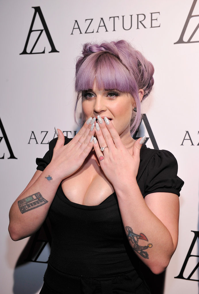 Remember Kelly Osbourne's thousand-dollar manicure? Well, she upped the glitter factor again. At the Azature Black Diamond Affair, she showed off an allegedly million-dollar manicure to help raise funds for charity. We're also intrigued by her braided-crown hairstyle.
