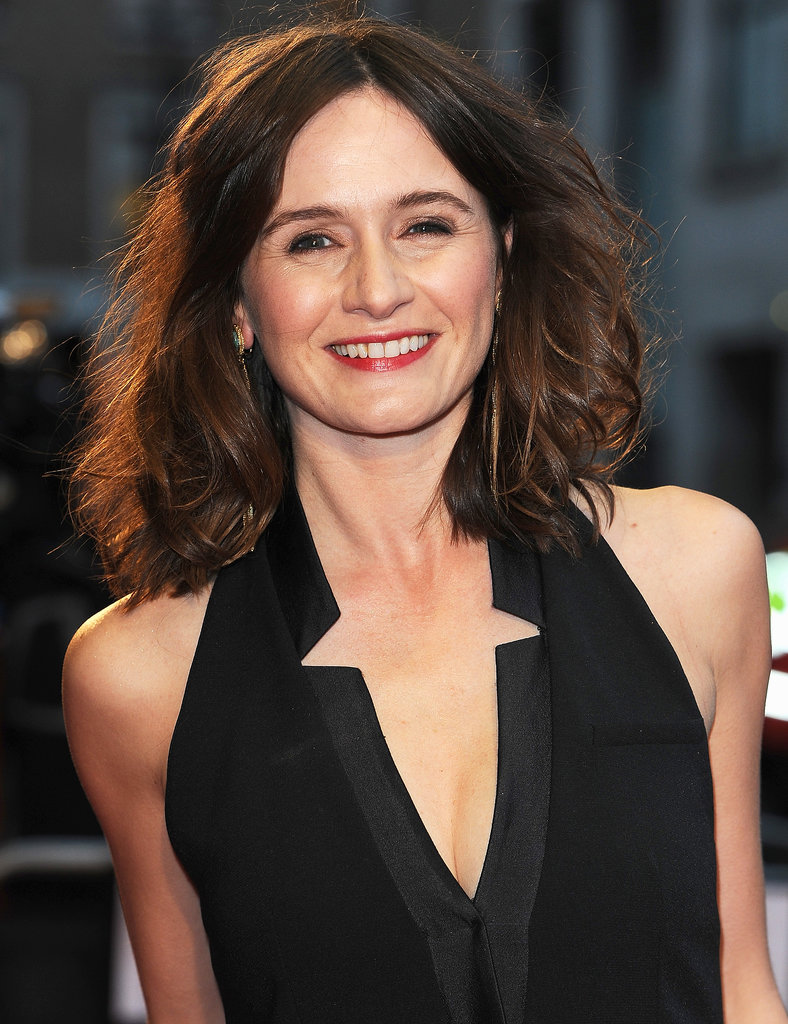 Stepping out for her show Doll & Em, Emily Mortimer looked radiant with shimmering lids and a red lipstick.