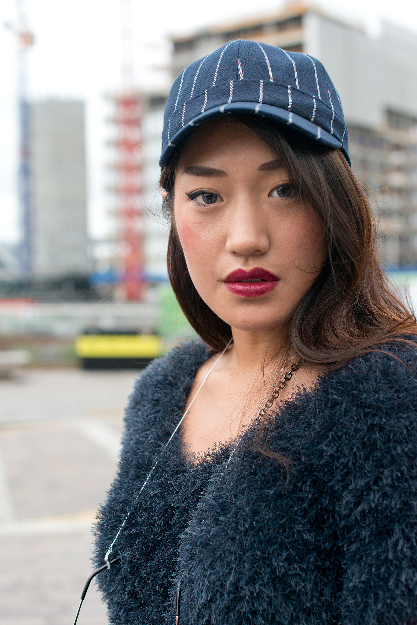 Keep things glossy by opting for a sleek blowout under your baseball cap.