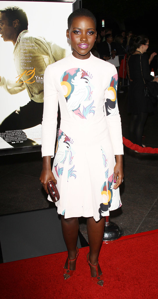 Lupita Nyong'o burst onto the scene in a colorful and quirky printed Miu Miu dress at the LA premiere of 12 Years a Slave.