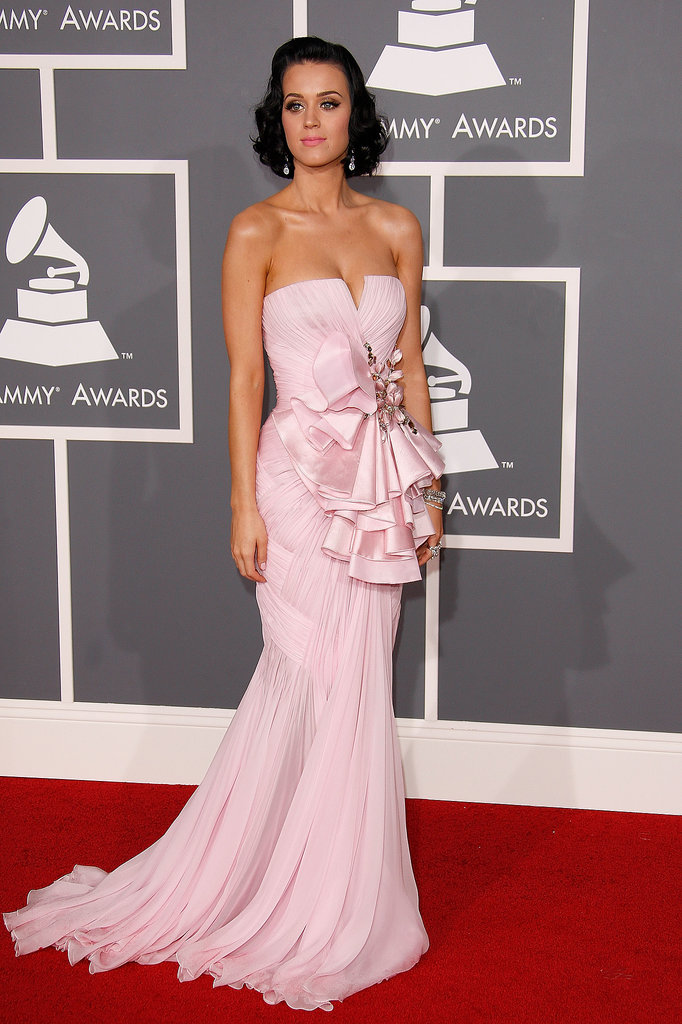Katy Perry brough a little old Hollywood glamour to the 2009 Grammy red carpet with retro curls and a strapless pale pink chiffon Basil Soda gown featuring bejeweled, layered ruffles at her waist.