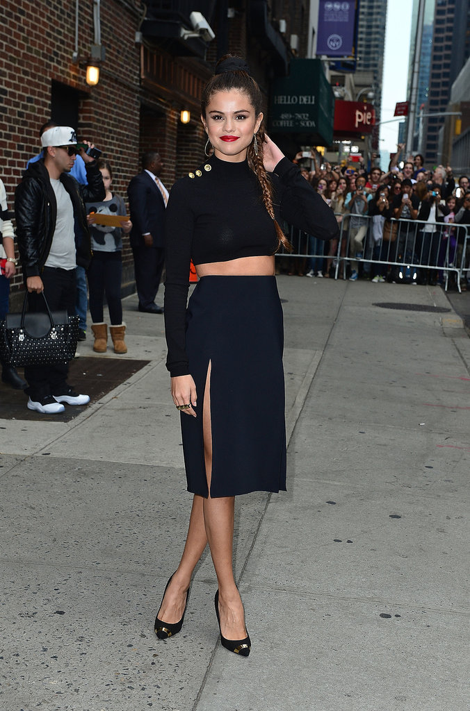 For her appearance on the Late Show With David Letterman, Selena opted for a black crop top with gold buttons paired with double slitted black skirt from J.W. Anderson's collection for Versus Versace.