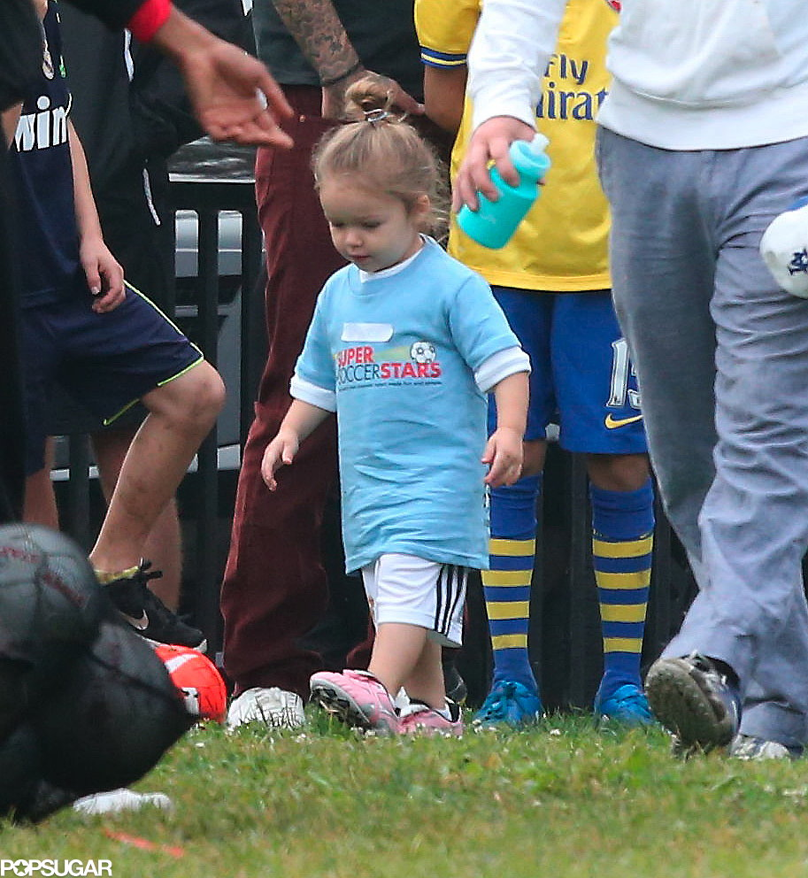 Harper Beckham's number-one fans, Victoria Beckham and David Beckham, watched her play soccer from the sidelines.
