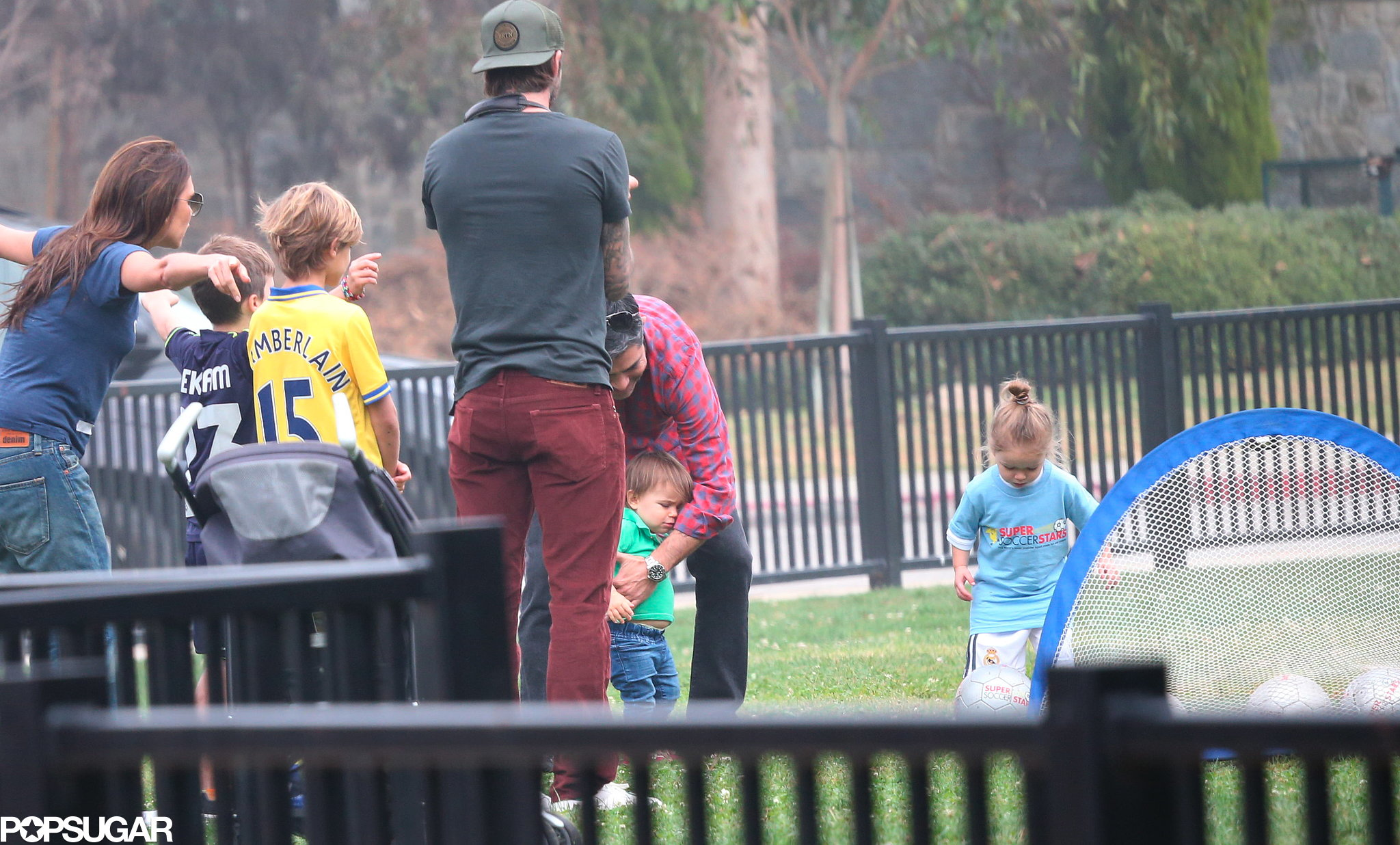 David Beckham and Victoria Beckham rooted for their little one, Harper, while she played soccer.