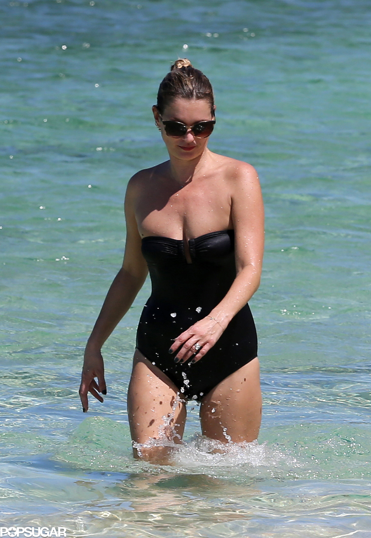 Kate Moss waded in the ocean.