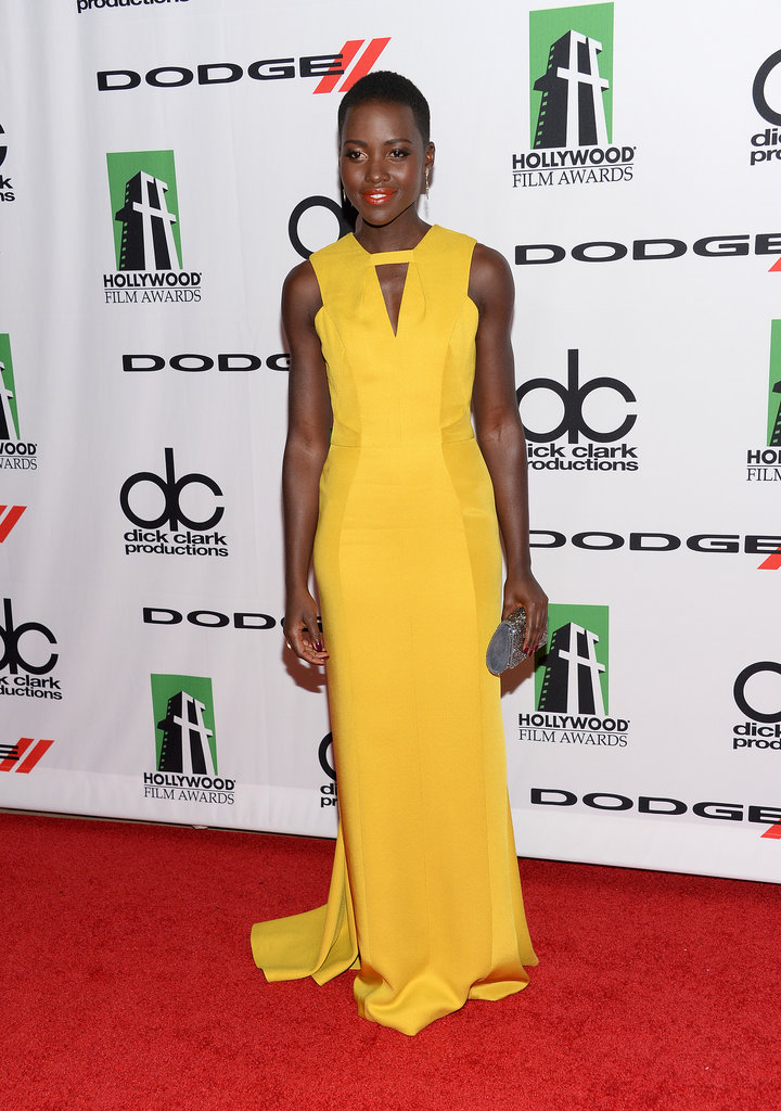 Lupita Nyong'o worked the red carpet in a long yellow dress at the Hollywood Film Awards.