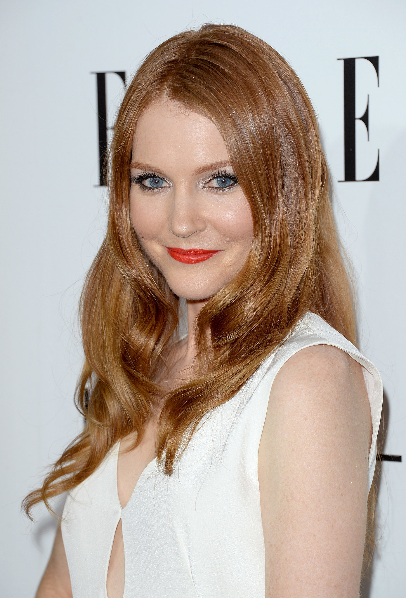 Darby Stanchfield was firing on all cylinders at the Women in Hollywood party with her red hair and red lipstick combo.