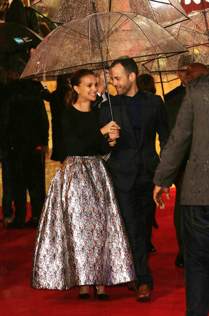 Benjamin Millepied joined his wife, Natalie Portman, under an umbrella to stay dry at the Thor: The Dark World world premiere in London on Tuesday.