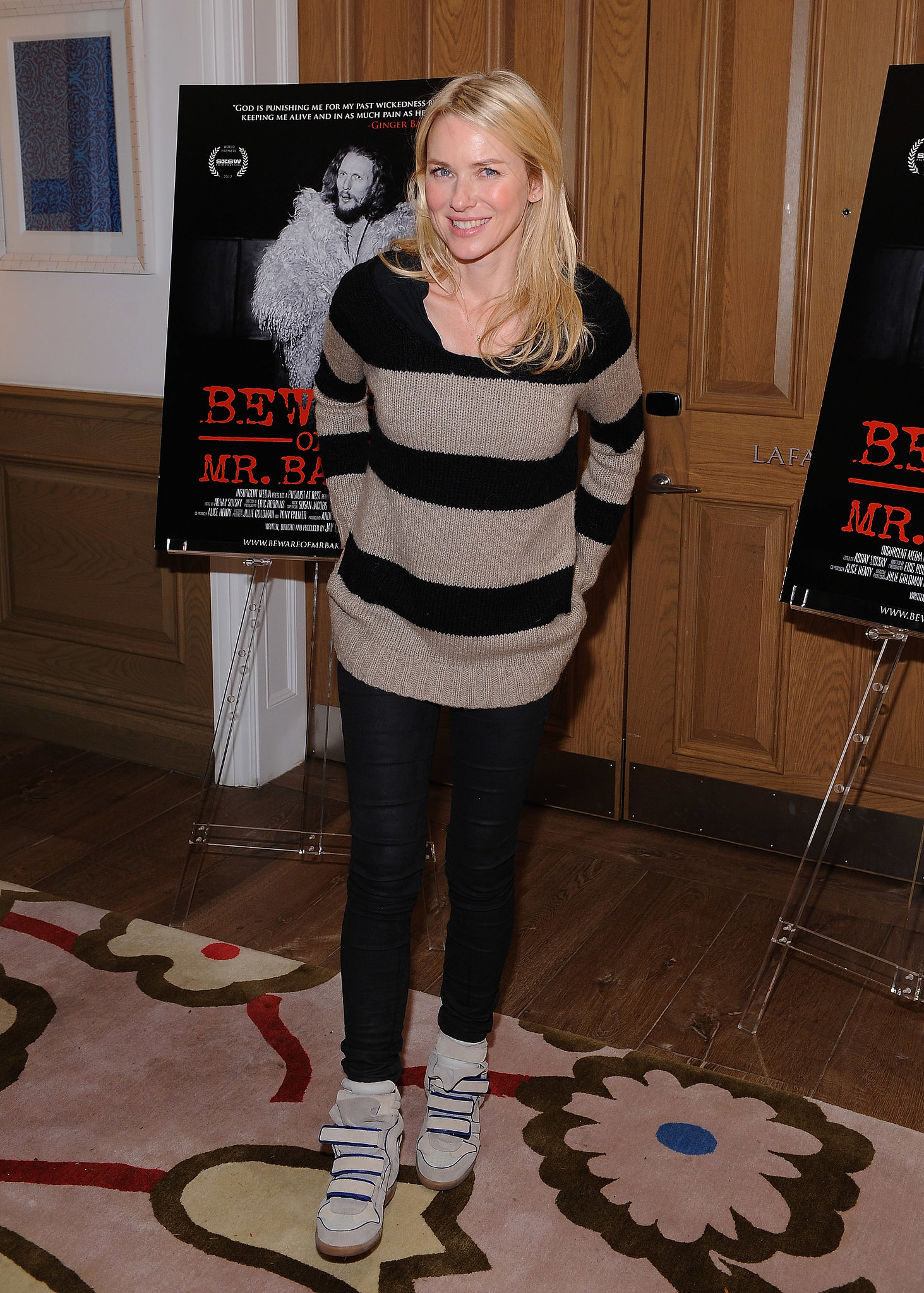 Naomi Watts matched a cozy striped sweater and black pants ...