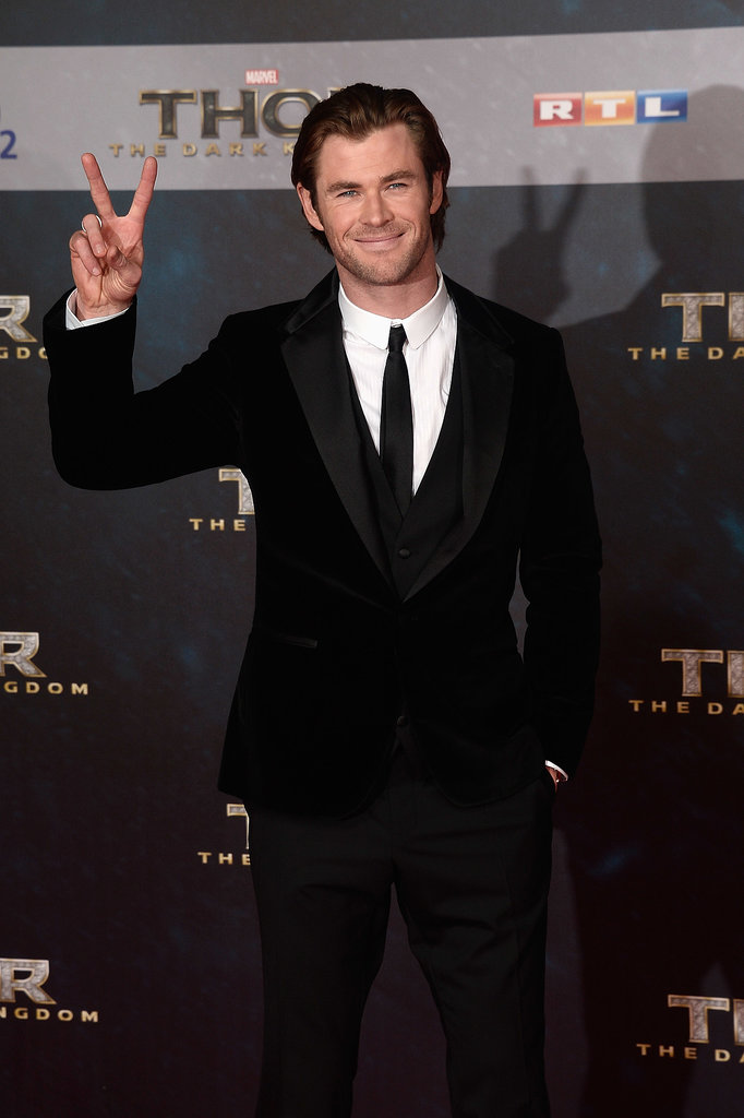 Chris Hemsworth flashed a peace sign at the German premiere.
