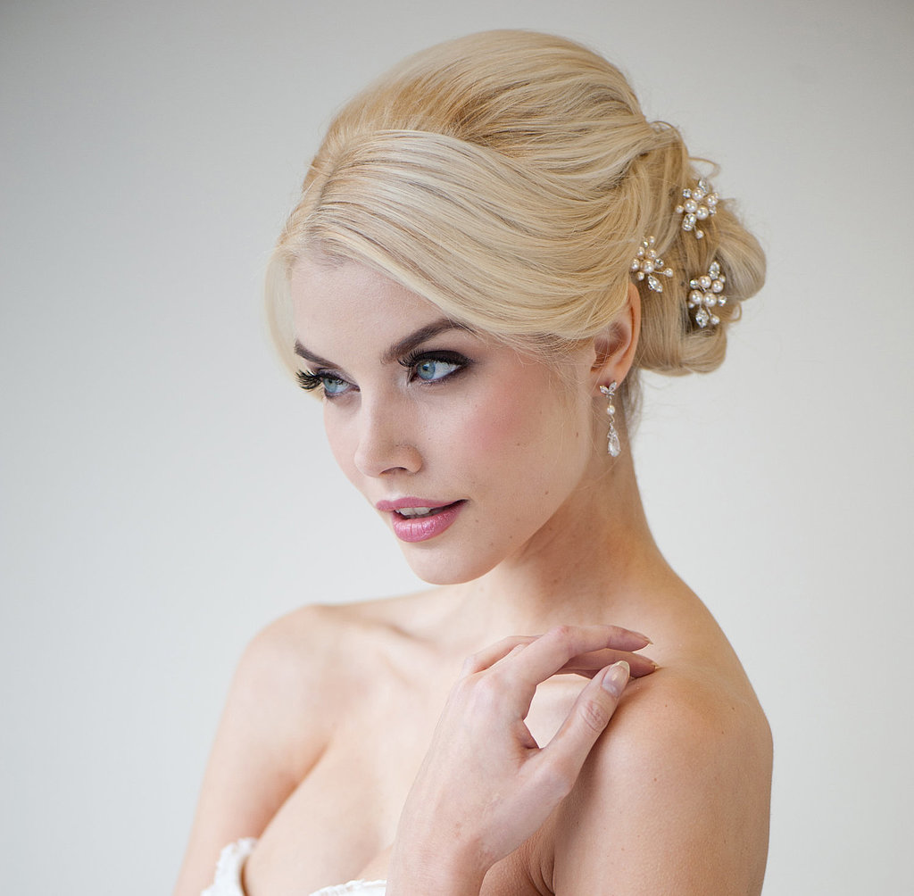 Add a little sparkle to your sophisticated updo by adding some delicate pearl pins ($58) to your hair.