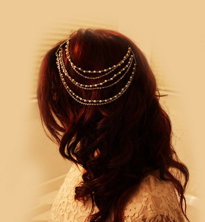 Go for something a little more unique with a golden pearl hair chain ($45), which would look great in an updo or all-down hairstyle.
