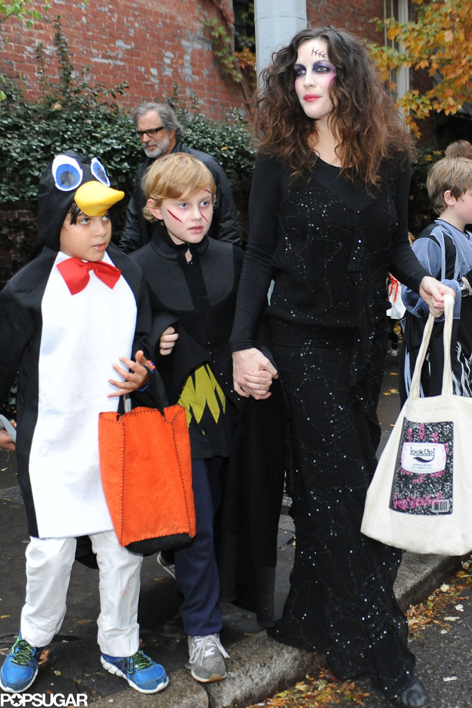 Liv Tyler held hands with her son while getting candy in NYC.