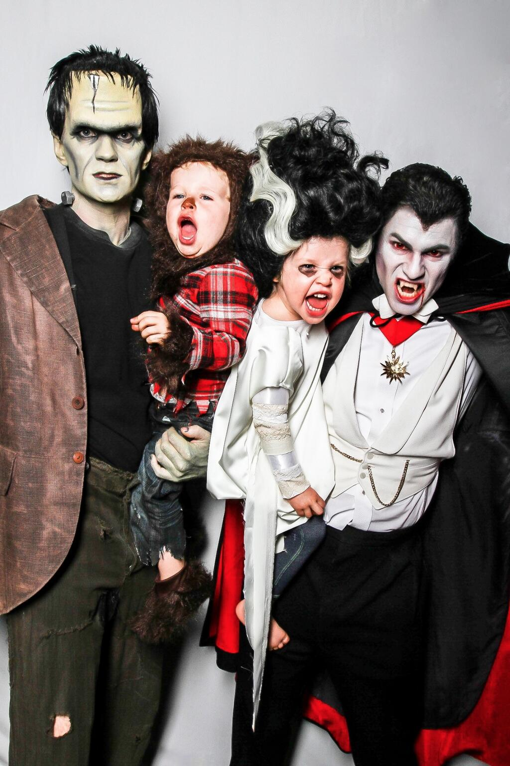 Neil Patrick Harris and his husband David Burtka dressed as Frankenstein and Dracula while their twins, Gideon and Harper, w