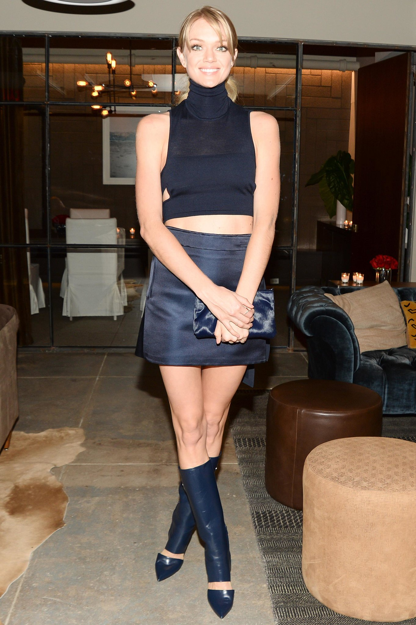 Lindsay Ellingson bared her midriff in Ferragamo's dark designs while screening Walking Stories .