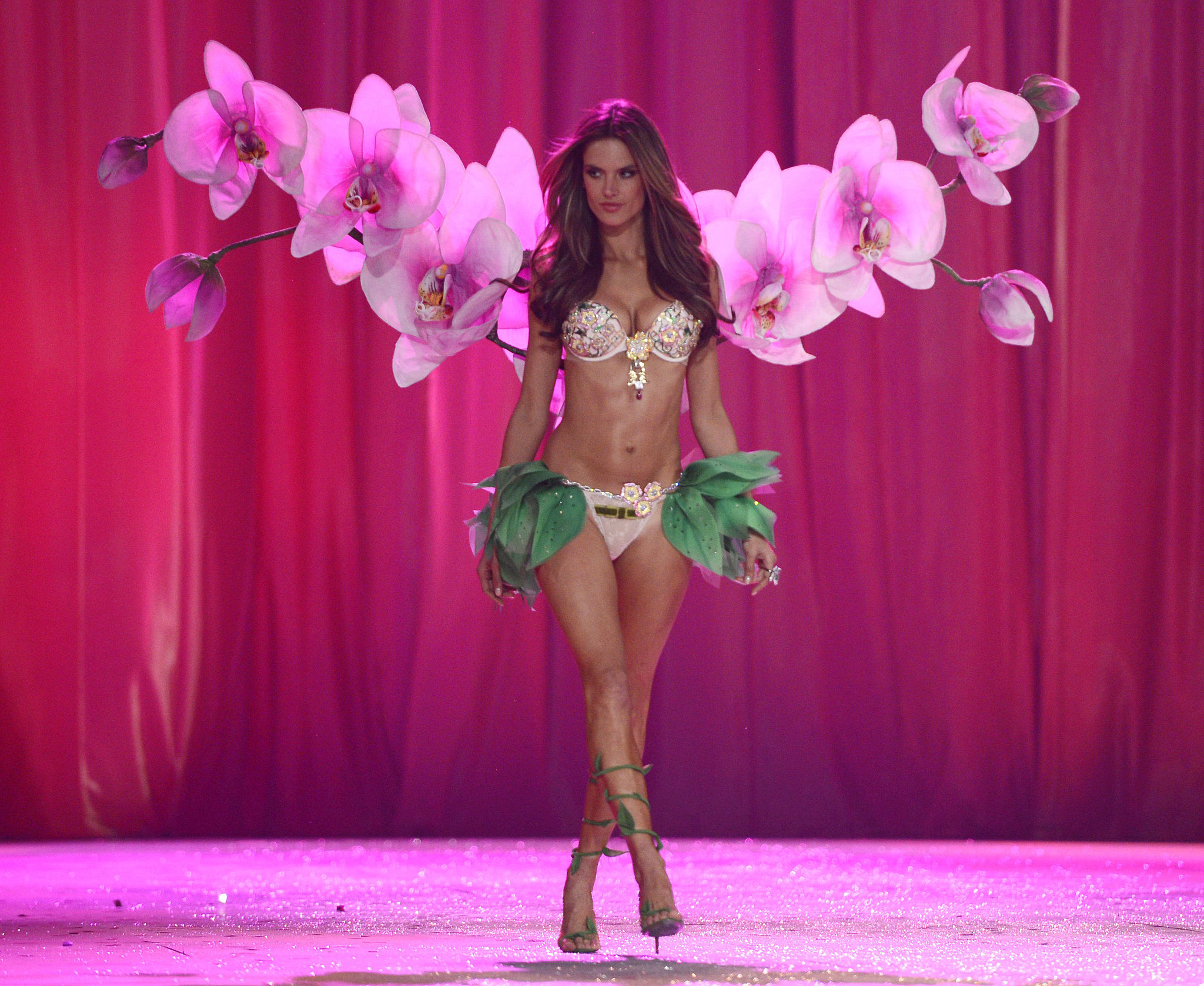 Alessandra Ambrosio sported orchids and leaves on the runway in 2012.