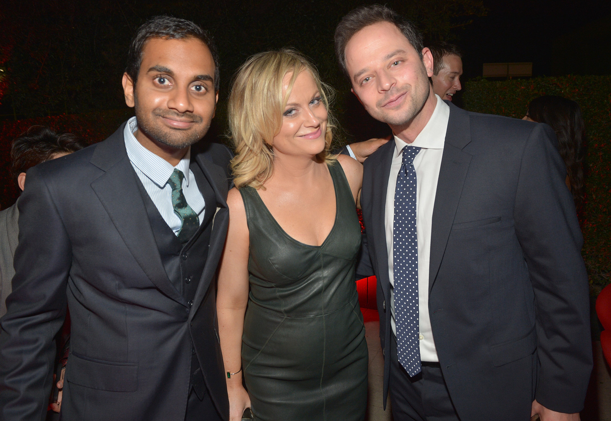 Amy Poehler spent time with her boyfriend, Nick Kroll, and Parks and Recreation costar Aziz Ansari.