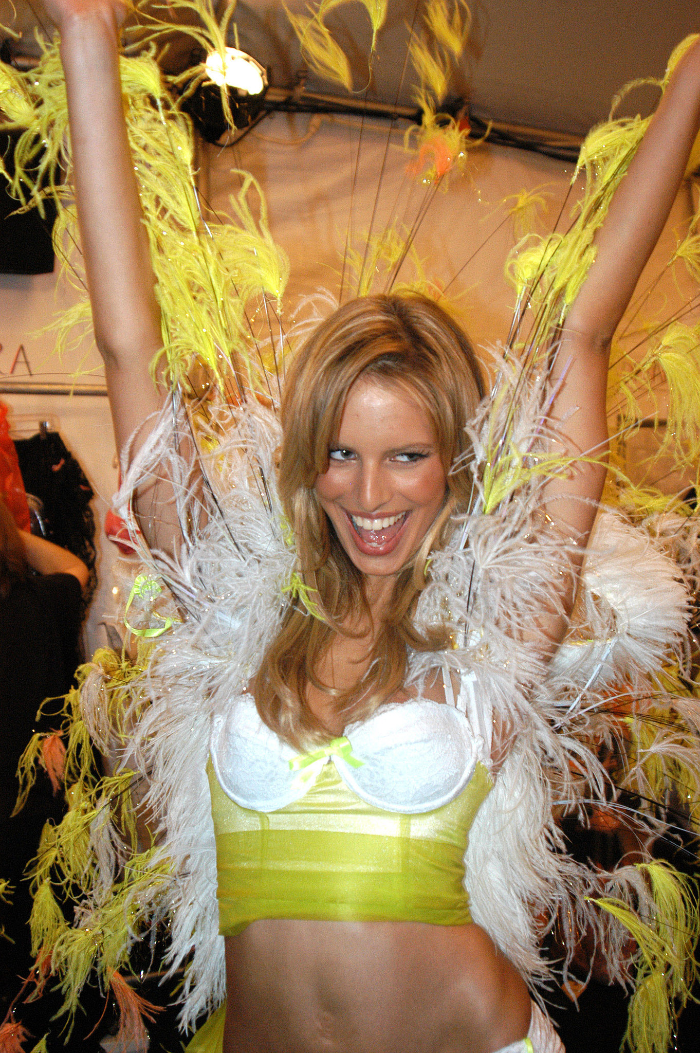 Karolina Kurkova celebrated in her feathered getup while backstage in 2002.