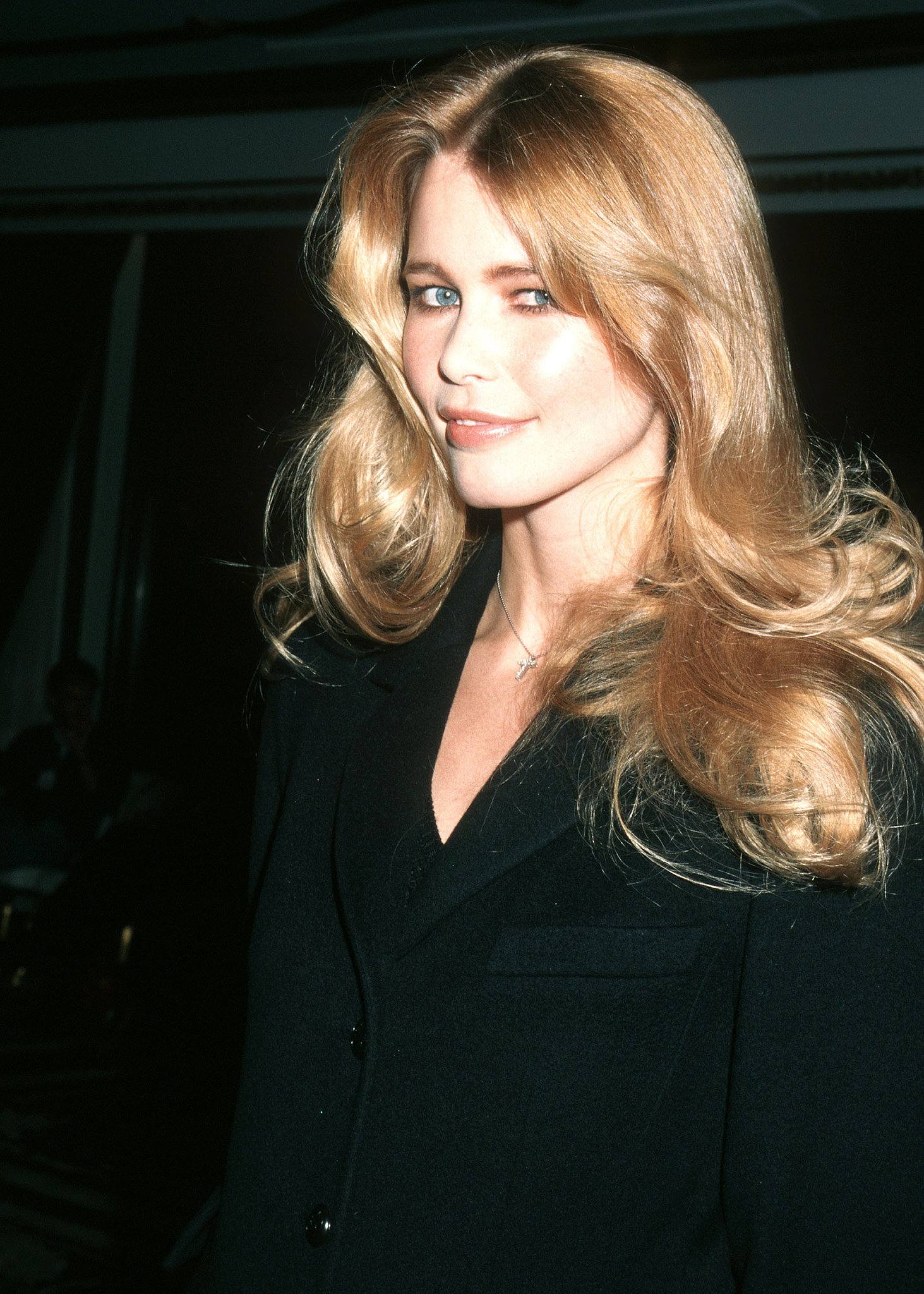 A young Claudia Schiffer smiled for the camera while backstage in 1997.