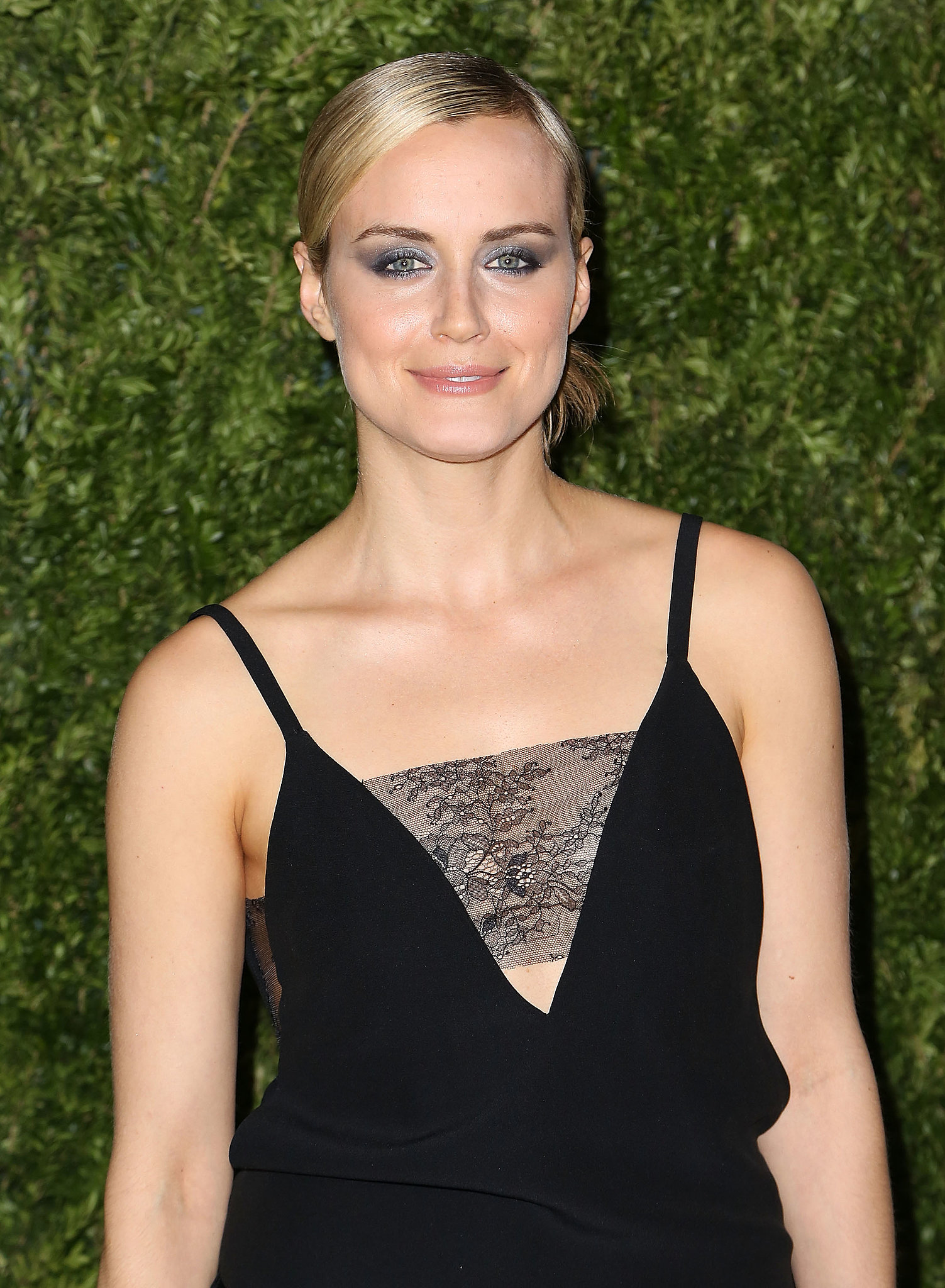 Taylor Schilling went high drama with her eye makeup and sleek with her updo.