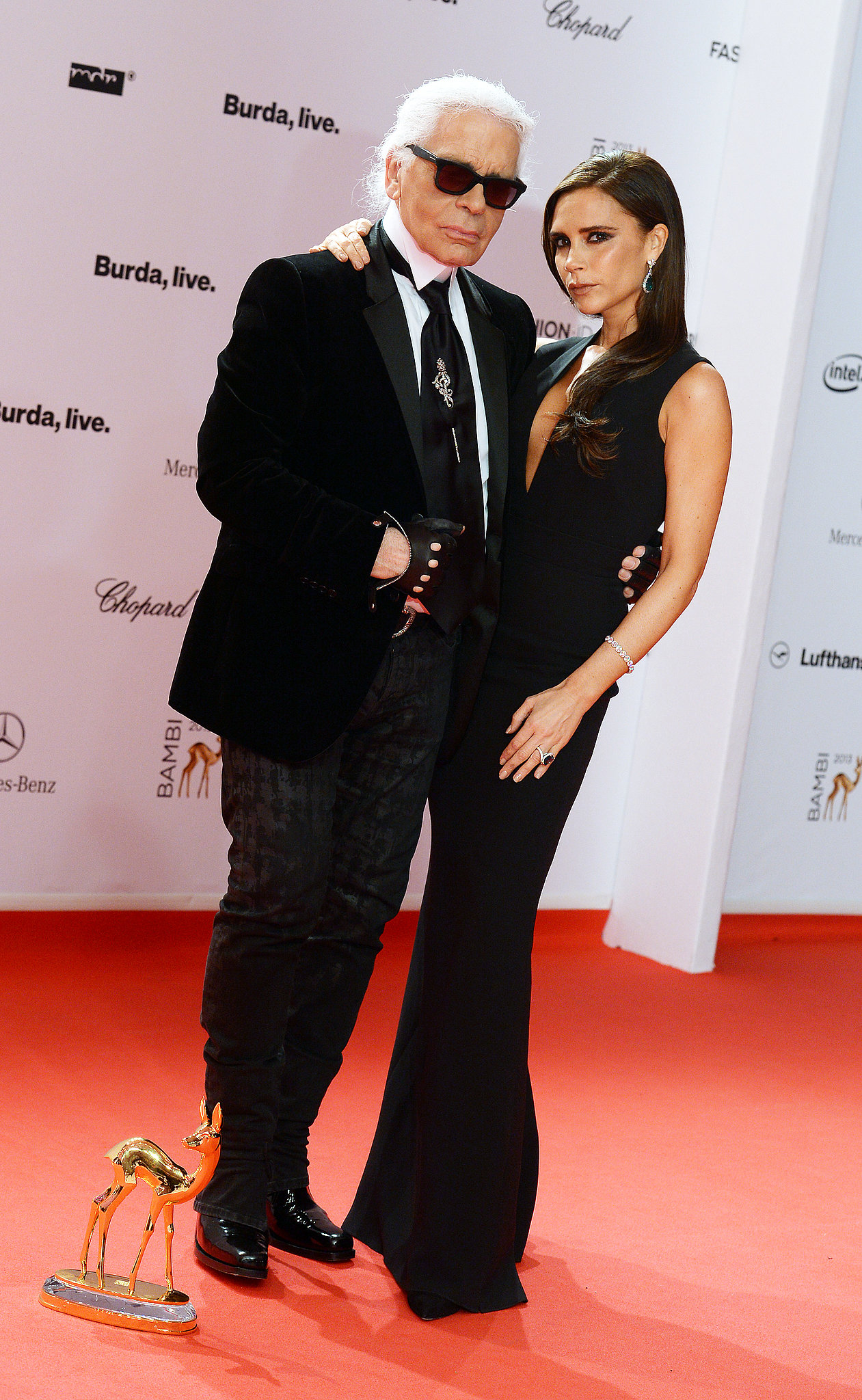 Karl Lagerfeld and Victoria Beckham in Chopard at the Bambi Awards.